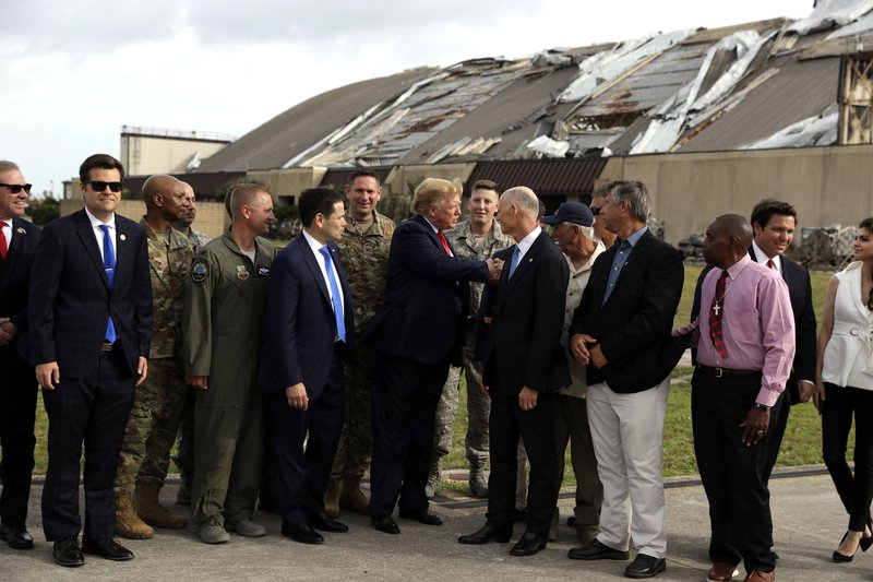 President Donald Trump tours Tyndall Air Force Base and views damage from Hurricane Michael Wednesday, May 8, 2019, in Tyndall Air Force Base, Fla. (AP Photo/Evan Vucci)