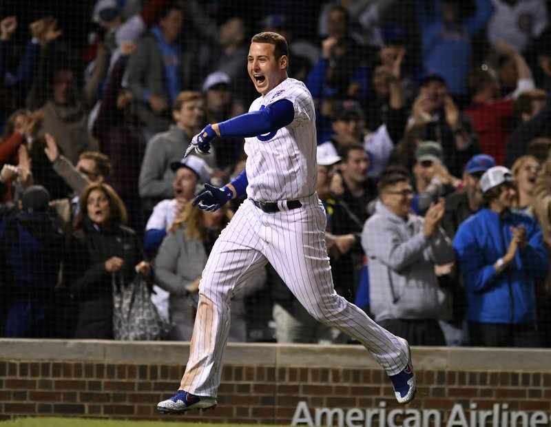 Chicago Cubs' Anthony Rizzo celebrates after Jason Heyward hit a game-winning solo home run in the 11th inning of a baseball game against the Miami Marlins on Wednesday, May 8, 2019, in Chicago. (AP Photo/Paul Beaty)