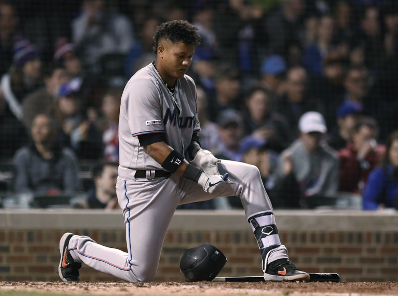 Miami Marlins' Starlin Castro reacts after striking out during the sixth inning of the team's baseball game against the Chicago Cubs on Wednesday, May 8, 2019, in Chicago. (AP Photo/Paul Beaty)