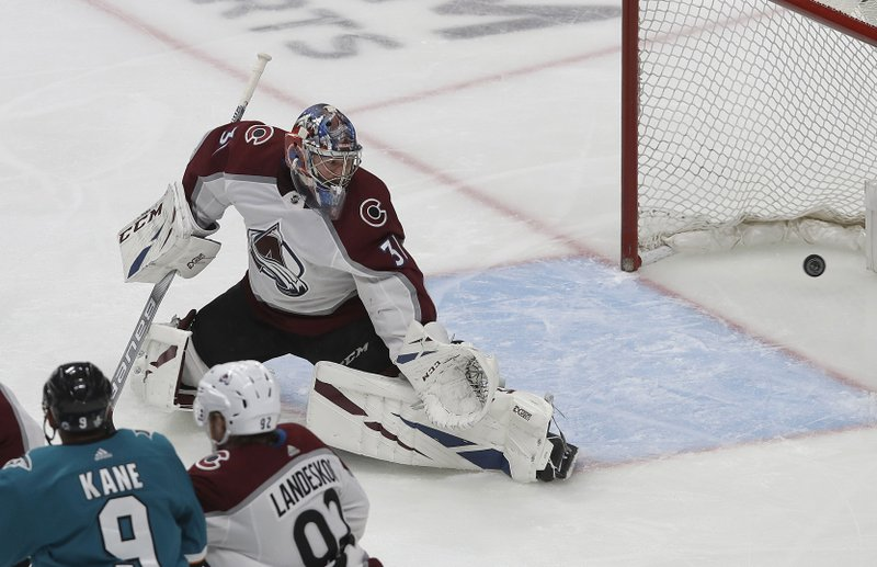 Colorado Avalanche goaltender Philipp Grubauer (31) looks back as San Jose Sharks center Joe Pavelski scores a goal during the first period of Game 7 of an NHL hockey second-round playoff series in San Jose, Calif. (AP Photo/Jeff Chiu)