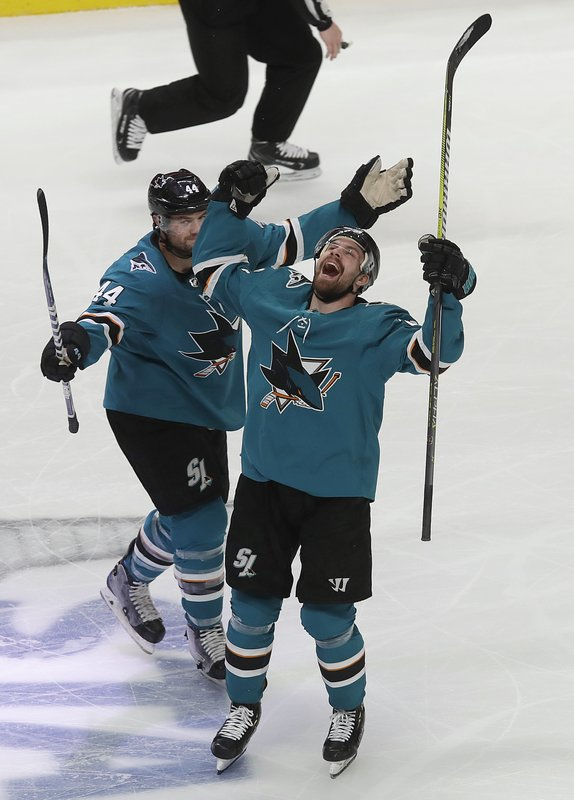 San Jose Sharks right wing Joonas Donskoi, right, celebrates with defenseman Marc-Edouard Vlasic (44) after scoring a goal against the Colorado Avalanche during the second period of Game 7 of an NHL hockey second-round playoff series in San Jose, Calif. (AP Photo/Jeff Chiu)