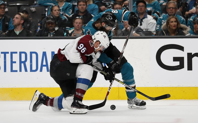 Colorado Avalanche right wing Mikko Rantanen (96) and San Jose Sharks defenseman Brent Burns (88) battle for the puck during the second period of Game 7 of an NHL hockey second-round playoff series in San Jose, Calif. (AP Photo/Josie Lepe)