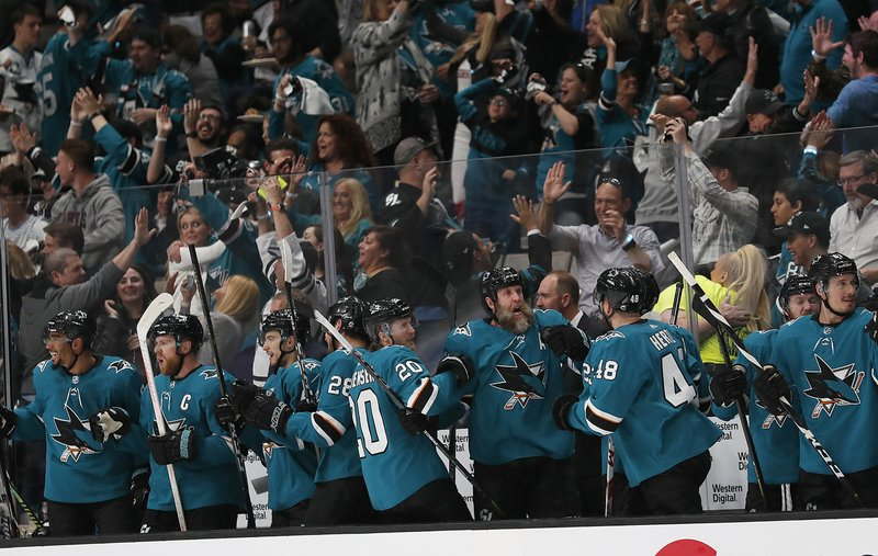 San Jose Sharks players and fans celebrate after Joonas Donskoi scored a goal against the Colorado Avalanche during the second period of Game 7 of an NHL hockey second-round playoff series in San Jose, Calif. (AP Photo/Josie Lepe)