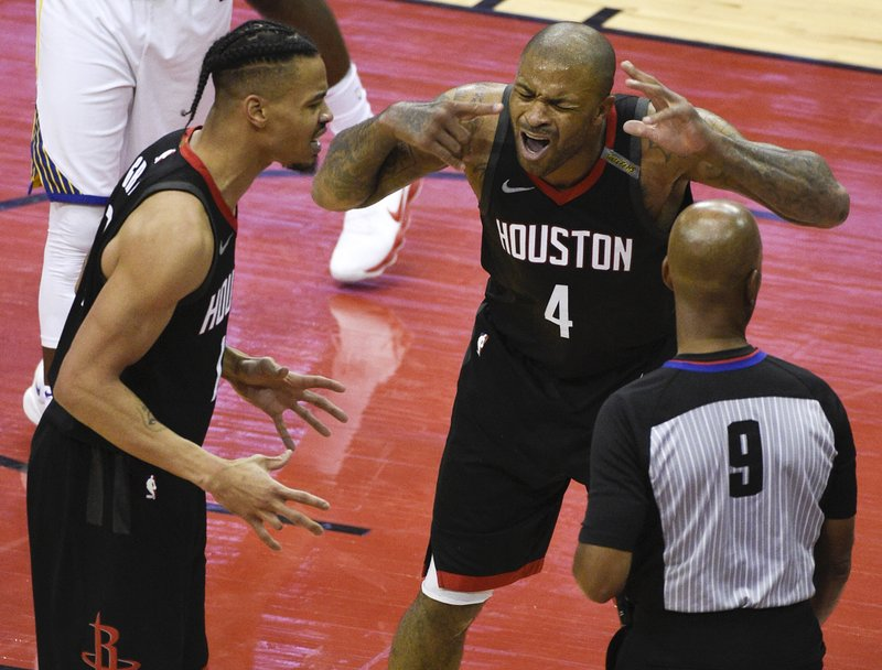 FILE - In this May 28, 2018, file photo, Houston Rockets forward PJ Tucker (4) and guard Gerald Green, left, argue a call with official Derrick Stafford during the second half of Game 7 of the NBA basketball Western Conference Finals against the Golden State Warriors, in Houston. (AP Photo/Eric Christian Smith, File)