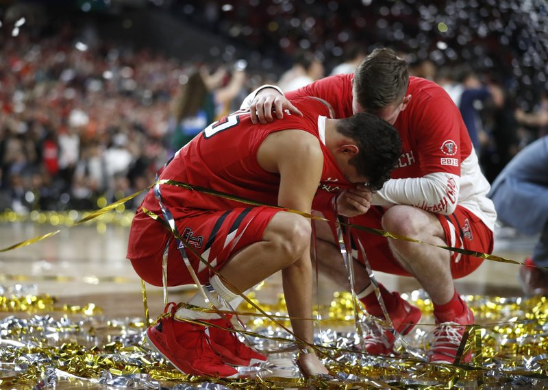 FILE - In this April 8, 2019, file photo, Texas Tech guard Davide Moretti, left, reacts with a teammate at the end of the championship game against Virginia in the Final Four NCAA college basketball tournament, in Minneapolis. (AP Photo/Jeff Roberson, File)