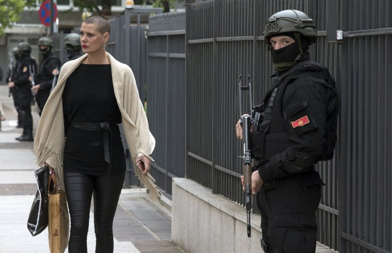 Montenegro police officers guard the entrance to the court building during the verdict in the case of ''attempted terrorism'' and ''creating a criminal organization'', in Podgorica, Montenegro, Thursday, May 9, 2019. (AP Photo/Risto Bozovic)