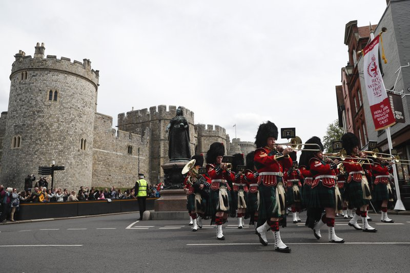 The Royal Regiment of Scotland band march by Windsor Castle, in Windsor, south England, Tuesday, May 7, 2019, a day after Prince Harry announced that his wife Meghan, Duchess of Sussex, had given birth to a boy. (AP Photo/Alastair Grant)