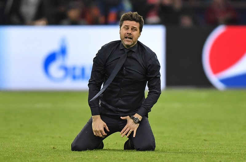 Tottenham manager Mauricio Pochettino celebrates on the pitch after his team scored their third goal during the Champions League semifinal second leg soccer match between Ajax and Tottenham Hotspur at the Johan Cruyff ArenA in Amsterdam, Netherlands, Wednesday, May 8, 2019. (AP Photo/Martin Meissner)