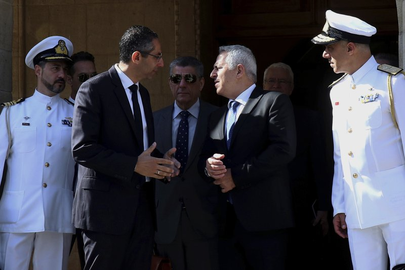 Cyprus' defense Minister Savvas Angelides, second left, talks with his Greek counterpart Evaggelos Apostolakis after their meeting with Cyprus' president Nicos Anastasiades at the presidential palace in Nicosia, Cyprus, Wednesday, May 8, 2019. (AP Photo/Philipps Christou)
