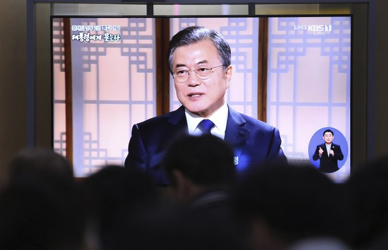 People watch a TV screen showing a live broadcast of South Korean President Moon Jae-in during a TV talk show with KBS at the Seoul Railway Station in Seoul, South Korea, Thursday, May 9, 2019. (AP Photo/Ahn Young-goon)