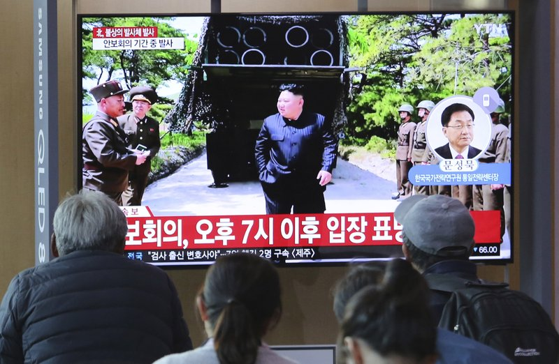 People watch a TV showing a file photo of North Korean leader Kim Jong Un, top center, during a news program at the Seoul Railway Station in Seoul, South Korea, Thursday, May 9, 2019. (AP Photo/Ahn Young-joon)
