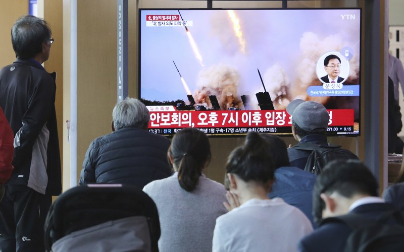 People watch a TV showing a file photo of North Korea's weapon systems during a news program at the Seoul Railway Station in Seoul, South Korea, Thursday, May 9, 2019. (AP Photo/Ahn Young-joon)