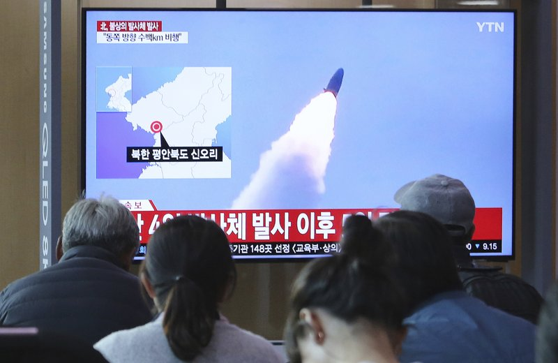 People watch a TV showing file footage of North Korea's missile launch during a news program at the Seoul Railway Station in Seoul, South Korea, Thursday, May 9, 2019. (AP Photo/Ahn Young-joon)