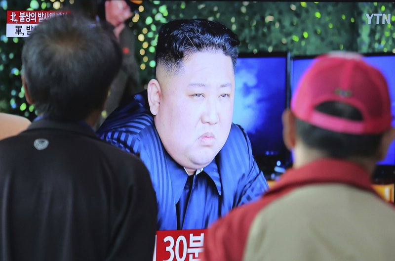 People watch a TV showing a file photo of North Korean leader Kim Jong Un during a news program at the Seoul Railway Station in Seoul, South Korea, Thursday, May 9, 2019. (AP Photo/Ahn Young-joon)