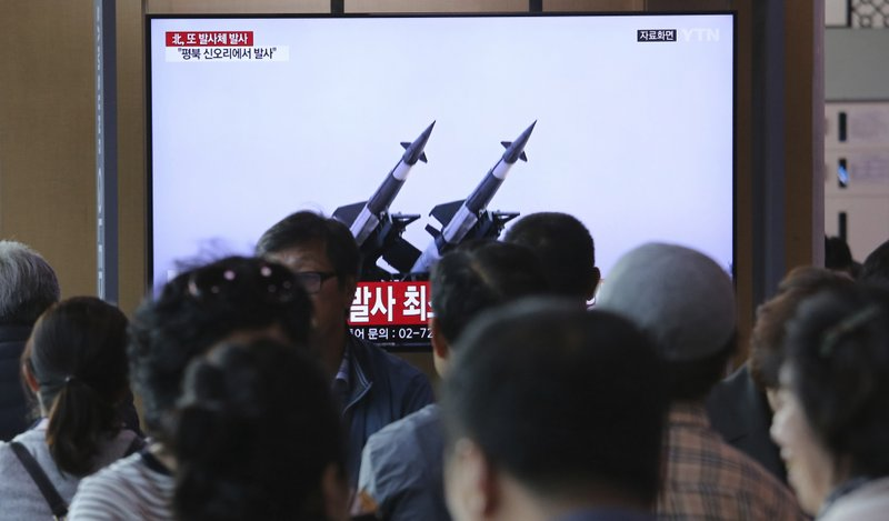 People watch a TV showing a file footage of North Korea's missiles during a news program at the Seoul Railway Station in Seoul, South Korea, Thursday, May 9, 2019. (AP Photo/Ahn Young-joon)