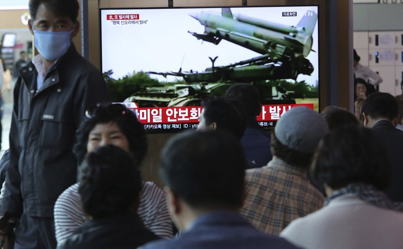 People watch a TV showing file footage of North Korea's missile during a news program at the Seoul Railway Station in Seoul, South Korea, Thursday, May 9, 2019. (AP Photo/Ahn Young-joon)