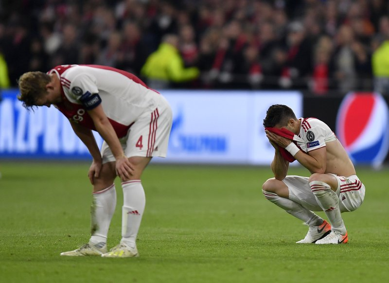 Ajax players react at the end of the Champions League semifinal second leg soccer match between Ajax and Tottenham Hotspur at the Johan Cruyff ArenA in Amsterdam, Netherlands, Wednesday, May 8, 2019. (AP Photo/Martin Meissner)