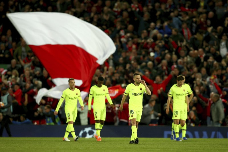 Barcelona players leave the playing field after losing the Champions League semifinal, second leg, soccer match against Liverpool at the Anfield stadium in Liverpool, England, Tuesday, May 7, 2019. (AP Photo/Dave Thompson)