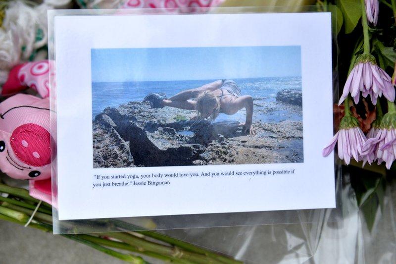 In this Wednesday, May 8, 2019, photo a photo is displayed at the memorial for Jessica Bingaman, a popular dog walker, who was killed along with five of six dogs she was transporting in Long Beach, Calif. (Brittany Murray/The Orange County Register via AP)