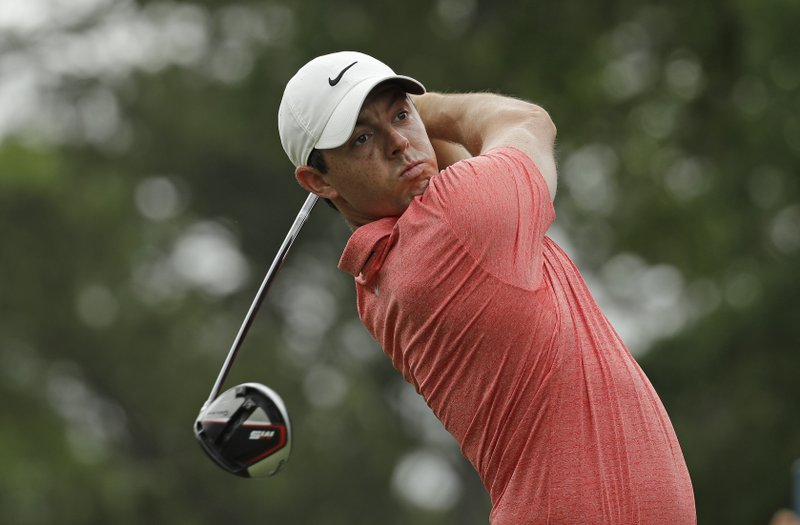 FILE - In this Sunday, May 5, 2019, file photo, Rory McIlroy, of Northern Ireland, watches his tee shot on the third hole during the final round of the Wells Fargo Championship golf tournament at Quail Hollow Club in Charlotte, N. (AP Photo/Chuck Burton, File)