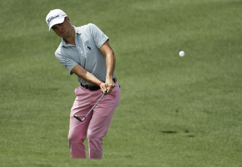 FILE - In this Thursday, April 11, 2019, file photo, Justin Thomas hits to the second green during the first round for the Masters golf tournament in Augusta, Ga. (AP Photo/Chris Carlson, File)