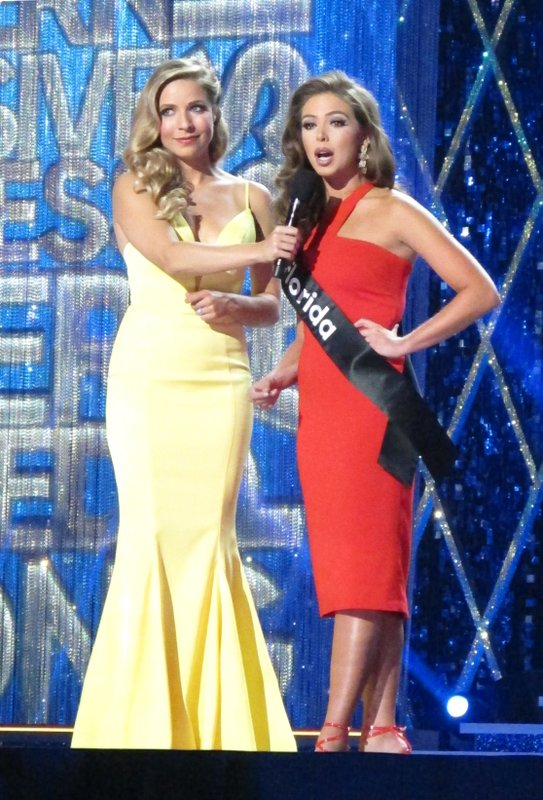 Miss America 2015 Kira Kazantsev, left, conducts an onstage interview with Miss Florida Taylor Tyson during the second night of preliminary competition in the Miss America competition in Atlantic City N. (AP Photo/Wayne Parry)