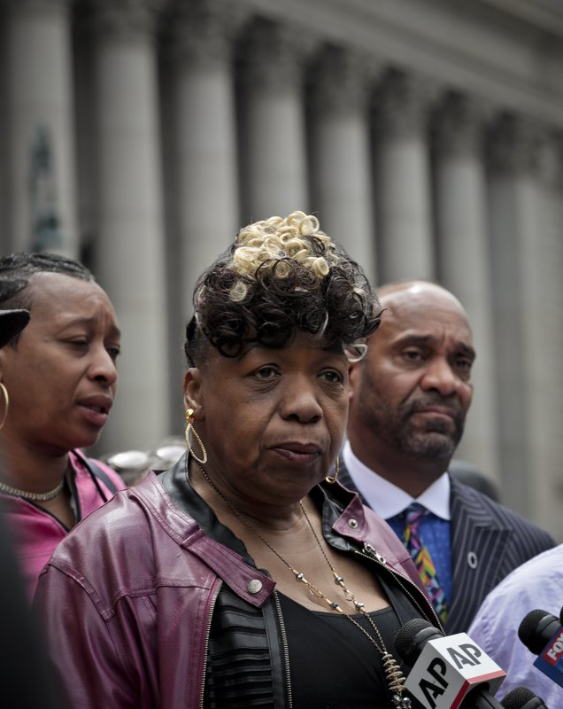 Gwen Carr, center, mother of Eric Garner, an unarmed black man who died as he was being subdued in a chokehold by police officer Daniel Pantaleo nearly five years ago, holds a news conference after leaving court, Thursday, May 9, 2019, in New York. (AP Photo/Bebeto Matthews)