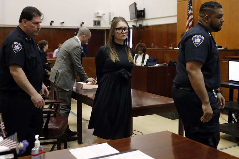 Anna Sorokin leaves after sentencing at New York State Supreme Court, in New York, Thursday, May 9, 2019. (AP Photo/Richard Drew)