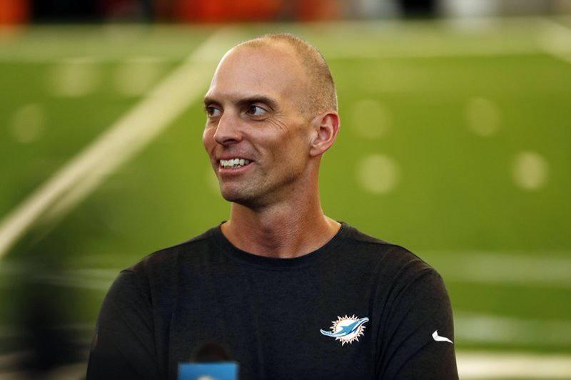Miami Dolphins offensive coordinator Chad O'Shea speaks to the media during NFL rookie camp on Thursday, May 9, 2019, in Davie, Fla. (AP Photo/Brynn Anderson)