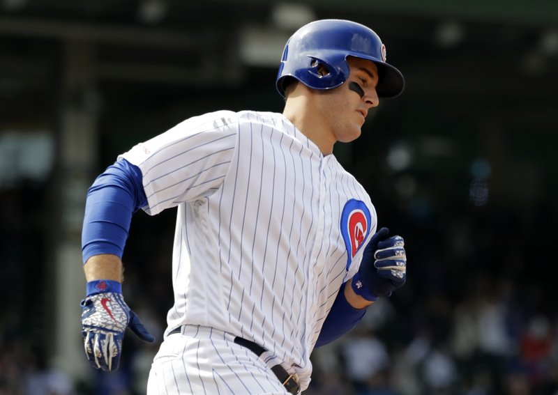 Chicago Cubs' Anthony Rizzo rounds the bases after hitting a two-run home run during the fifth inning of a baseball game against the Miami Marlins, Thursday, May 9, 2019, in Chicago. (AP Photo/Nam Y. Huh)