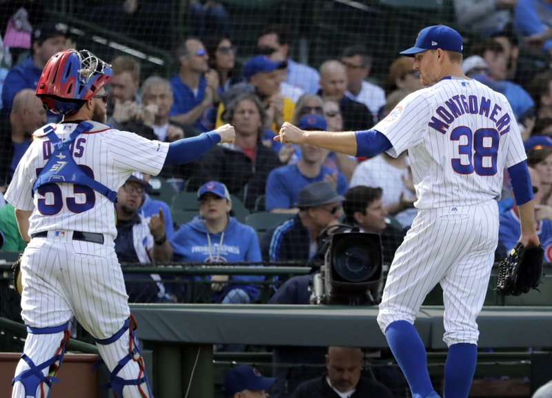 Chicago Cubs relief pitcher Mike Montgomery, right, celebrates with catcher Taylor Davis as they walk to the dugout during the eighth inning of a baseball game against the Miami Marlins, Thursday, May 9, 2019, in Chicago. (AP Photo/Nam Y. Huh)