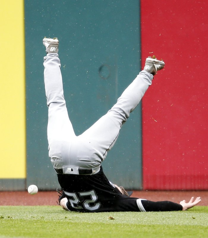Chicago White Sox's Charlie Tilson slips and falls trying to field a double by Cleveland Indians' Francisco Lindor during the fifth inning of a baseball game, Thursday, May 9, 2019, in Cleveland. (AP Photo/Ron Schwane)