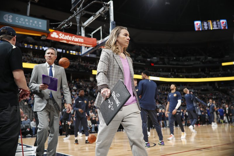 FILE - In this Dec. 28, 2018, file photo, San Antonio Spurs assistant coach Becky Hammon walks on the court before f an NBA basketball game against the Denver Nuggets in Denver. (AP Photo/David Zalubowski, File)