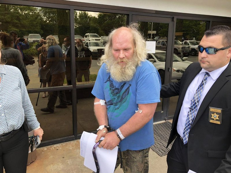 This photo taken from video provided by WSOC-TV shows suspect Edwin Hiatt after his arrest Thursday, May 9, 2019, in Burke County, N. (WSOC-TV via AP)