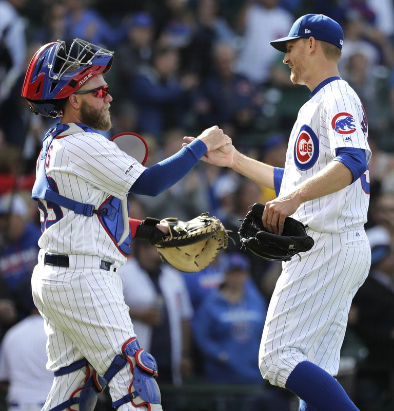 Chicago Cubs relief pitcher Mike Montgomery, right, celebrates with catcher Taylor Davis after the Cubs defeated the Miami Marlins 4-1 in a baseball game Thursday, May 9, 2019, in Chicago. (AP Photo/Nam Y. Huh)