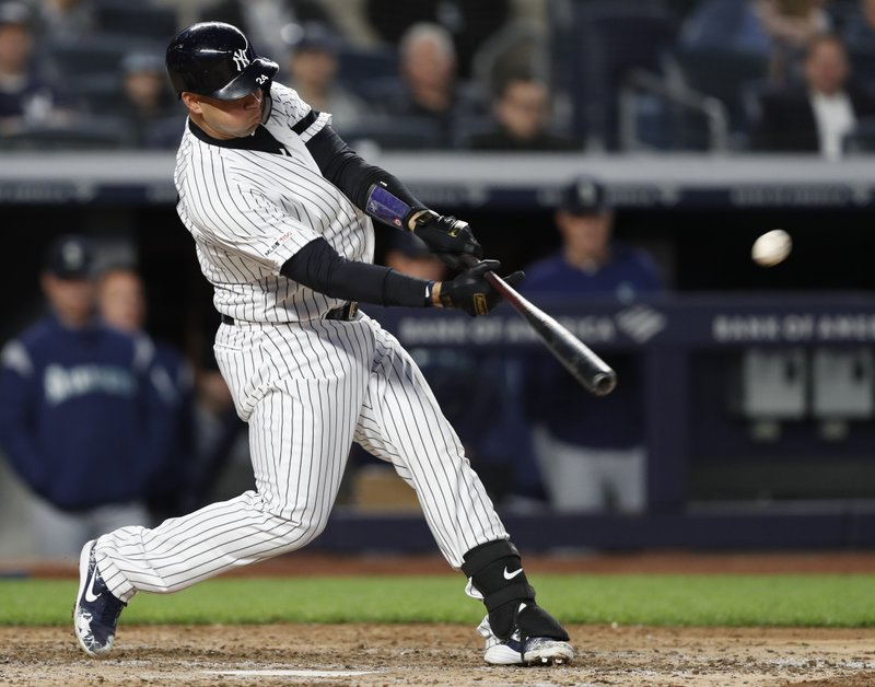 New York Yankees' Gary Sanchez hits a single against the Seattle Mariners during the eighth inning of a baseball game Thursday, May 9, 2019, in New York. (AP Photo/Kathy Willens)