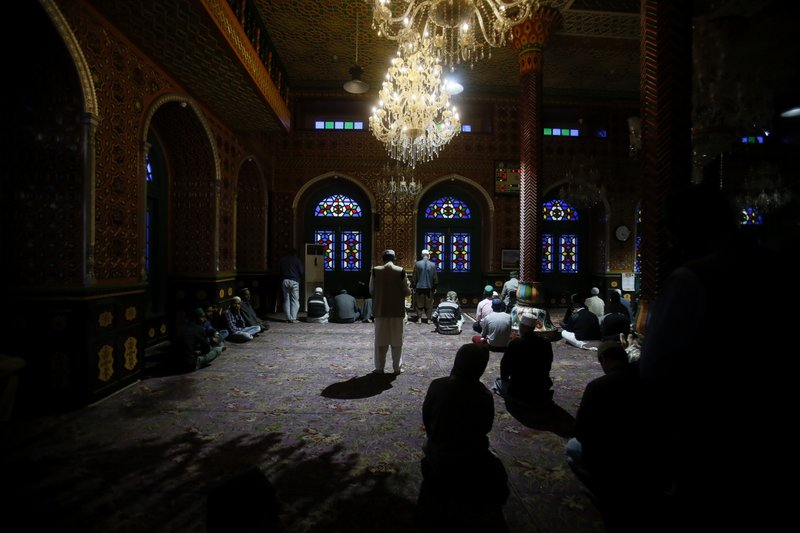 In this May 7, 2019, photo, Kashmiri Muslims offer prayers on the first day of fasting month of Ramadan inside a shrine in Srinagar, Indian controlled Kashmir. (AP Photo/Mukhtar Khan)