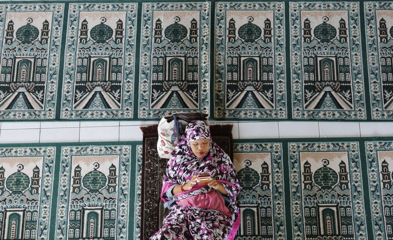 In this May 6, 2019, photo, a woman rests at a mosque during the first day of the holy fasting month of Ramadan in Bali, Indonesia. (AP Photo/Firdia Lisnawati)