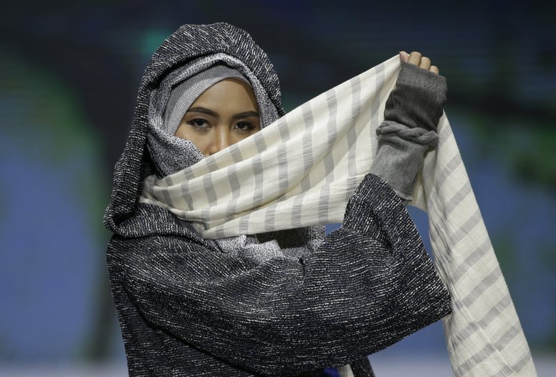 In this May 3, 2019, photo, model displays a creation by Rosie Rahmadi during the Muslim Fashion Festival in Jakarta, Indonesia. (AP Photo/Achmad Ibrahim)