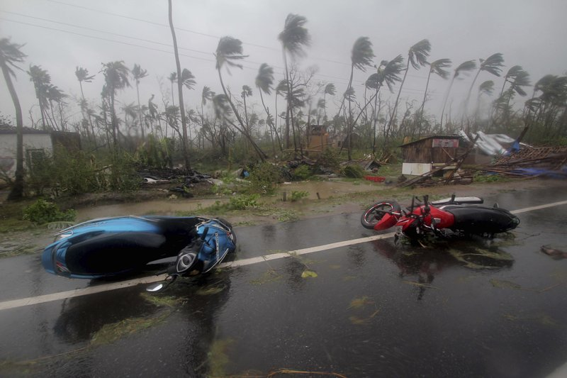In this May 3, 2019, photo, motorcycles lie on a street in Puri district after Cyclone Fani hit the coastal eastern state of Odisha, India. Cyclone Fani tore through India's eastern coast on Friday as a grade 5 storm, lashing beaches with rain and winds gusting up to 205 kilometers (127 miles) per hour and affecting weather as far away as Mount Everest as it approached the former imperial capital of Kolkata. (AP Photo)