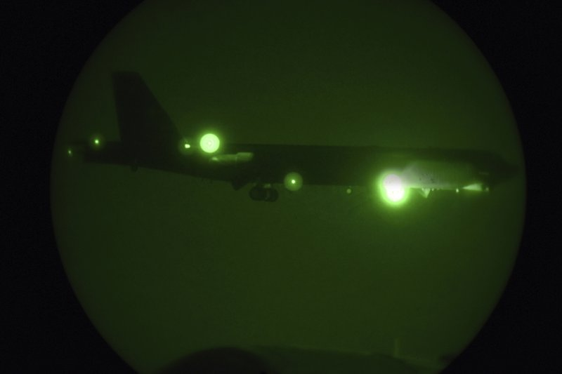 In this Thursday, May 9, 2019 photo released by the U.S. Air Force, a B-52H Stratofortress assigned to the 20th Expeditionary Bomb Squadron is seen through night vision coming in for a landing at Al Udeid Air Base, Qatar. (Staff Sgt. Ashley Gardner/U.S. Air Force via AP)