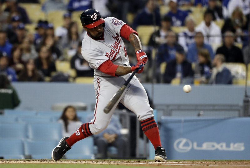 Washington Nationals' Howie Kendrick hits a three-run home run against the Los Angeles Dodgers during the first inning of a baseball game Thursday, May 9, 2019, in Los Angeles. (AP Photo/Marcio Jose Sanchez)