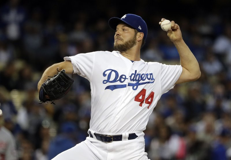 Los Angeles Dodgers starting pitcher Rich Hill throws to a Washington Nationals batter during the first inning of a baseball game Thursday, May 9, 2019, in Los Angeles. (AP Photo/Marcio Jose Sanchez)