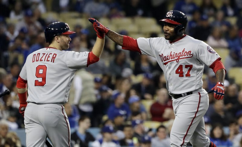 Washington Nationals' Howie Kendrick (47) celebrates his three-run home run with Brian Dozier (9) during the first inning of the team's baseball game against the Los Angeles Dodgers on Thursday, May 9, 2019, in Los Angeles. (AP Photo/Marcio Jose Sanchez)