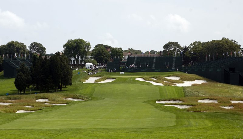 FILE - In this June 12, 2009, file photo, Bunkers line the fairway and protect the green on the 18th hole of Bethpage State Park's Black Course in Farmingdale, N. (AP Photo/Jason DeCrow, File)