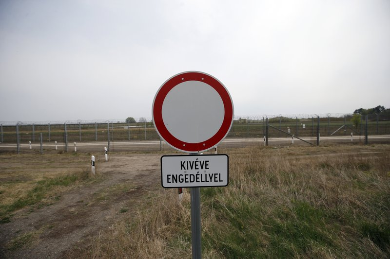 In this photo taken Monday, April 8, 2019, a road traffic warning sign reads: Except with a permit