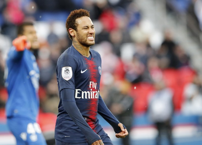 PSG's Neymar reacts after missing a scoring chance during the French League One soccer match between Paris Saint-Germain and Nice at the Parc des Princes stadium in Paris, France, Saturday, May 4, 2019. (AP Photo/Christophe Ena)