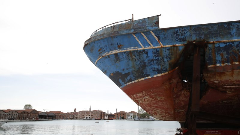 The wreck of the 'Barca Nostra' fishing boat, which sank in the Mediterranean Sea in 2015 with 700 migrants on board, is displayed at the 58th Biennale of Arts exhibition in Venice, Italy, Tuesday, May 7, 2019. (AP Photo/Antonio Calanni)