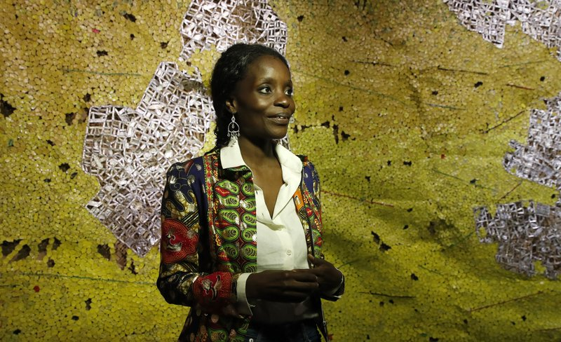 Ghana pavilion curator Nana Oforiatta Ayim smiles during the 58th Biennale of Arts exhibition in Venice, Italy, Tuesday, May 7, 2019. (AP Photo/Antonio Calanni)