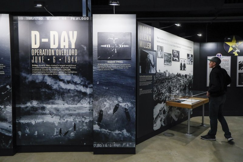 In this Friday, April 26, 2019 photo, visitors browse the D-Day displays at the The National Museum of the U. (AP Photo/John Minchillo)